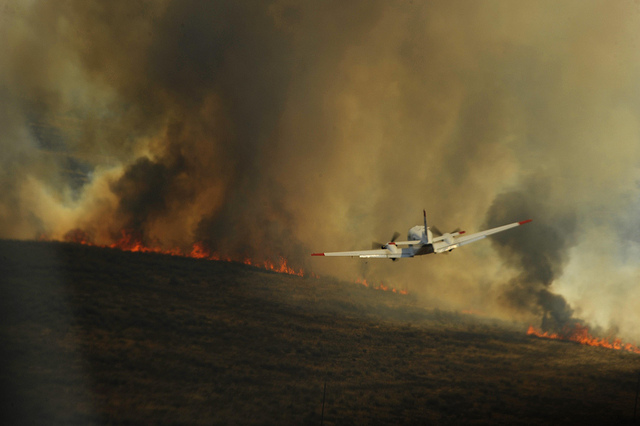 While the Mississippi River rises in historic floods a few hundred miles to the east. extreme heat and drought continue to afflict Texas with wildfires that so far have seared a thousand square miles. And there's more to come. (U.S. Air Force Photo/Staff Sgt. Eric Harris)