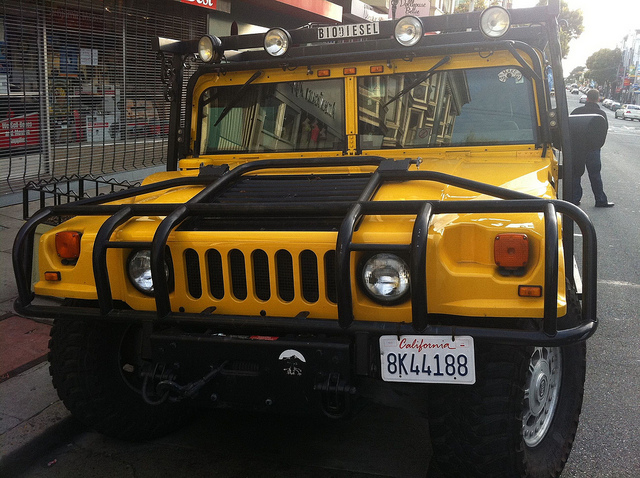 Converting a Hummer to bio-diesel, as this one has been,  is like having a diet drink after gorging at McPiggy's. As it turns out, converting an industry to bio-diesel makes about as much sense. (Photo by Paul Keller/Flickr)
