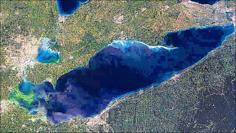 A satellite view released by NASA shows a blue-green algae bloom (the green part) taking over western Lake Erie (the blue part). And that's not all.