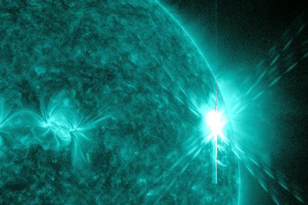 This image provided by NASA shows a solar flare early Tuesday, Aug. 9, the largest in 5 years. The image was was captured by NASA's Solar Dynamics Observatory (SDO) in extreme ultraviolet light.