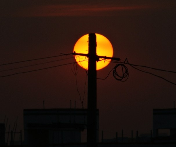 The sun and the power grid -- enemies in Texas today, but they could be the best sustainable friends. (Photo by pranav/flickr)