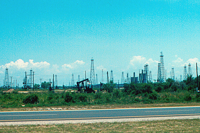 These oil wells were thick as fleas along the Texas coast in 1978, when America was awash in oil. But production has been declining since 1970, and simple-minded hype will not change that. (Photo by Roger Wollstad (Roger4336)/Flickr)