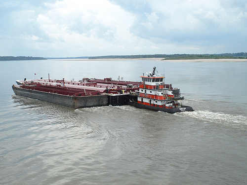 It's not easy being a Mississippi barge; 14 months ago they were being swept away by flood waters, now they're running aground in low water. (Photo by Brad Jones/Flickr)
