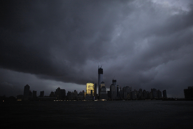 Lower Manhattan, lights out (except for that one building) watches Sandy approach and Braces for Impact. photo by Stefan Leijon/Flickr