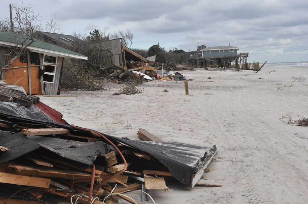 Superstorm Sandy not only did this to Fire Island, NY, but made it easier to do again. (Photo: Cheryl Hapke, USGS)