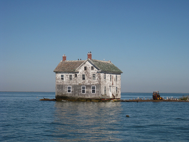 The last house on Holland Island in the Chesapeake Bay, possibly one of the first casualties of climate change induced storms and rising seas. Think they had any warning? (Photo by baldeaglebluff/Flickr)