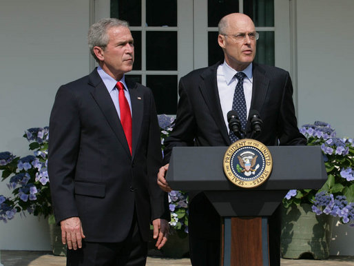 Henry Paulson (right) speaks at his nomination as Secretary of the Treasury. He lived through one crash. Now he sees another coming.