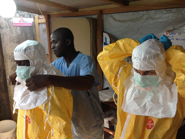 Health care workers in Guinea suit up before approaching patients infected with Ebola in the early days of an outbreak that has become a world health emergency. But it's not the only one. (Photo by the European Commission.)