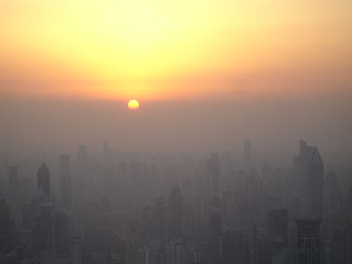 Sunset in Shanghai. Except that's not the horizon the sun is sinking behind, it's the pollution layer. (Photo By Suicup via Wikimedia Commons)
