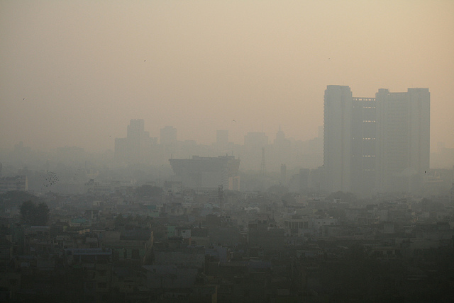 The air in Delhi, shown here in 2011, like the air in Beijing, is barely breathable by humans. Yet these two countries, with their 2.6 billion people, have just begun to burn fossil fuels. (Photo by je poirrier/Flickr)