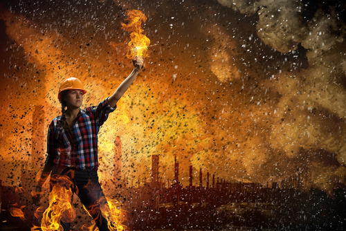 Thank God, it's an engineer, here to save us from the fire by pouring gasoline on us. (Photo by Sergei Nivens/Shutterstock)