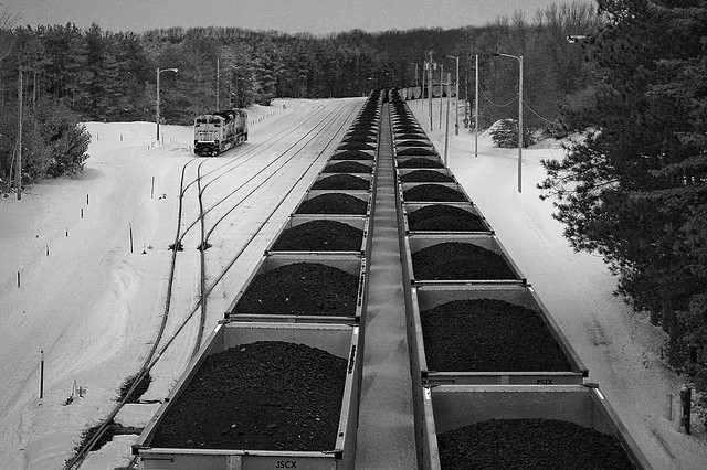 A coal train once supplied the city of Holland, Michigan with fuel for its electric generating plant. They converted the plant to natural gas. Their costs are down, their emissions are down, and coal is down for the count.  (Photo by wsilver/Flickr)