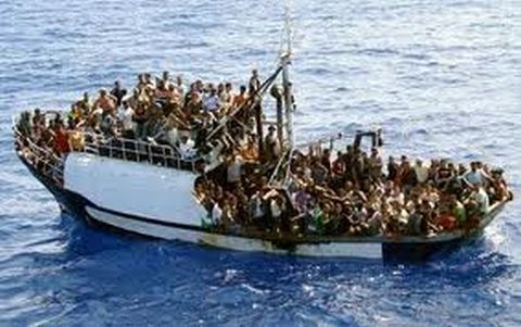 A typically overloaded boat carries Libyan refugees toward Europe. (Photo by notenoughgood.com)